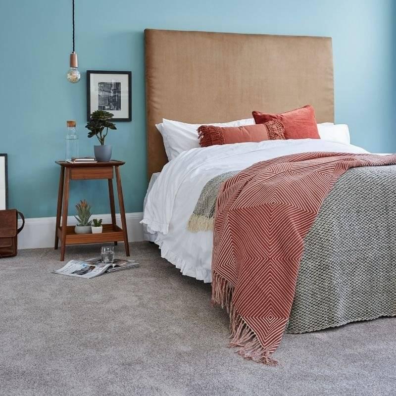 Cormer carpets, furniture display bedroom