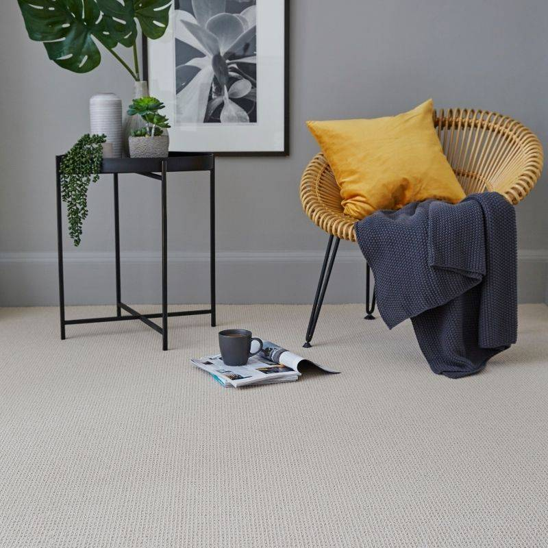 beige cord carpet next to chair and table