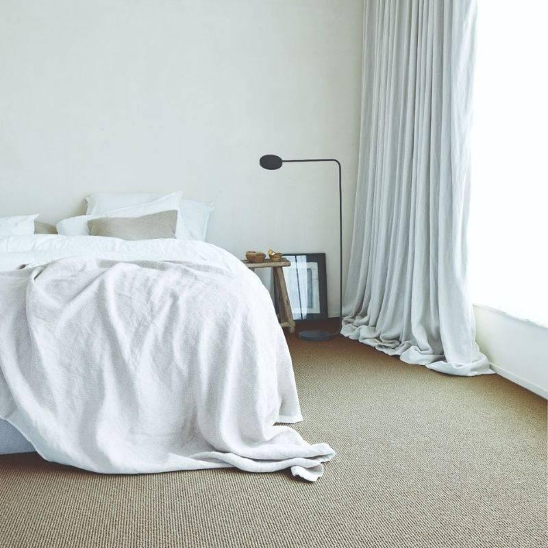 beige cord carpet in bedroom