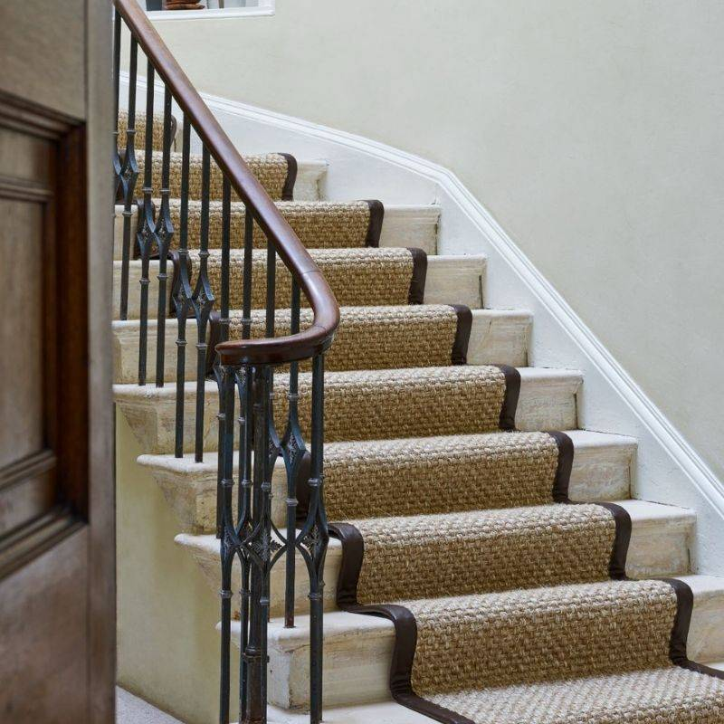 brown patterned carpet going up stairs